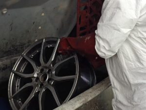 Chemically stripped wheel going into tank
