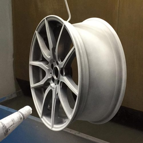 Final lacquer coat being applied to the side of the wheel