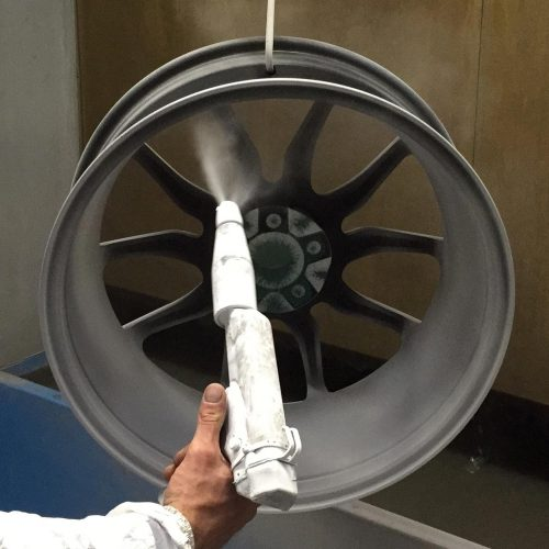 Final lacquer coat being applied to the rear of the wheel